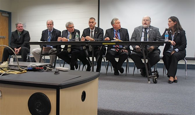 From left—Garrett Moore, William Harrell, Charlie Strunk, Tom Biesiadny, Leonard Wolfenstein, Randall White and Lauren Mullerup. Experts from both the Virginia and Fairfax County Departments of Transportation listened to area residents, answered questions and addressed concerns about the Fairfax County Parkway.
