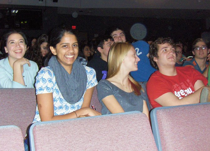 Roshni Gorur (in scarf) enjoys a laugh with classmates at the programs end.