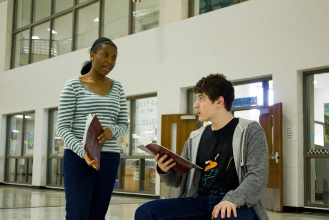 "Binta Barry and Joshua Ewalt rehearse a scene from ""Cabaret."" Barry plays Sally Bowles and Ewalt plays American writer Cliff Bradshaw."