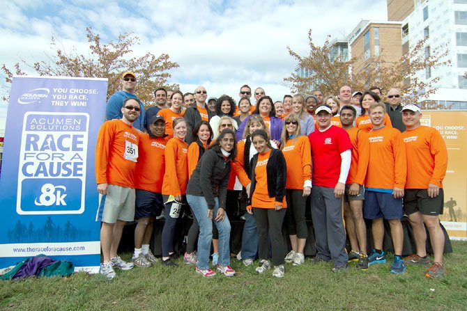 "The fourth annual Acumen Solutions Race for a Cause 8K and 1-Mile Fun Run raised money for local nonprofit ""superheroes."" The McLean-based Acumen team is pictured here."