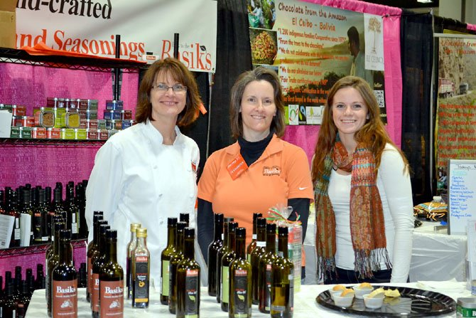 Anne Shomberg (left) of Basiks at Home, in Reston, pictured with her daughter Amy Shomberg and sister-in-law Tamra Mehlberg (center), shares her spices, seasonings, vinegars and oils with visitors at the 2012 Metropolitan Cooking and Entertaining Show in Washington.