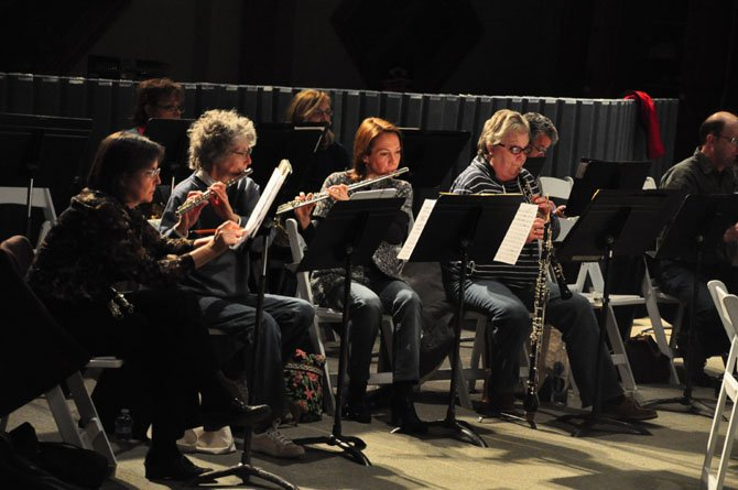 Members of the Reston Community Orchestra rehearse in preparation of their 25th season at the Sunset Hills Montessori School.