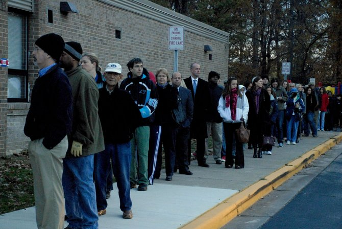 Voters lined up outside Lake Anne Elementary early Tuesday morning. Voters reported about a 45-minute wait at Lake Anne Elementary.