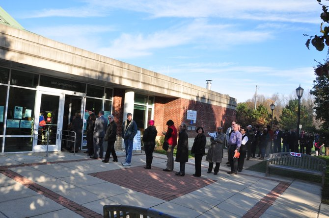Voters line up in front of the Great Falls Library Tuesday, Nov. 6 to cast their votes.