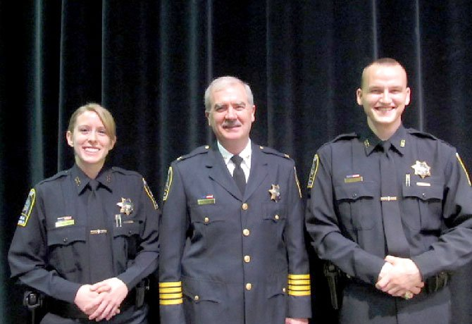 From left: Officer Katherine R. Holcombe, Col. Robert A. Carlisle and Officer John M. Digan.