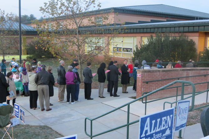 Voters stand in line at Colvin Run Elementary School at 6:30 a.m. during the morning's heaviest turnout.