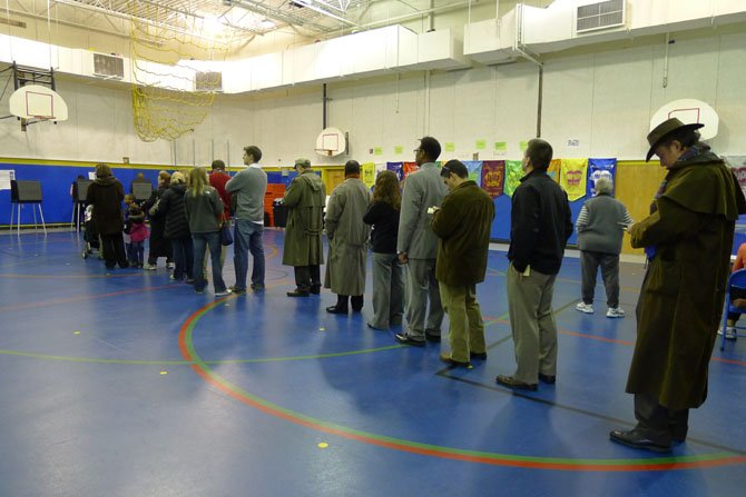 People wait to vote at Barcroft polling place at 8 a.m.