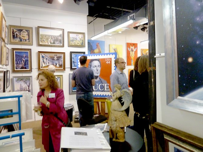 Guests and guest painter at the gallery event.