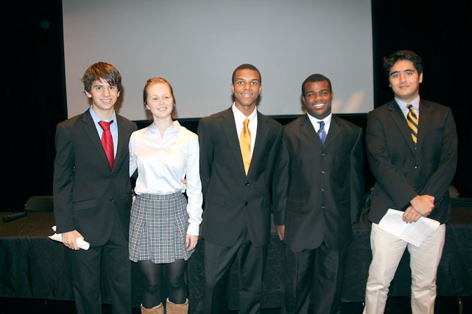The candidates and moderator, from left: Teddy Sullivan '15 as Mitt Romney; Sioned Vaughan '14 as Jill Stein (Green Party); Zach Wood '14, moderator; JD Dyer '13 as Barack Obama; Arman Salmasi '15 as Gary Johnson (Libertarian Party).
