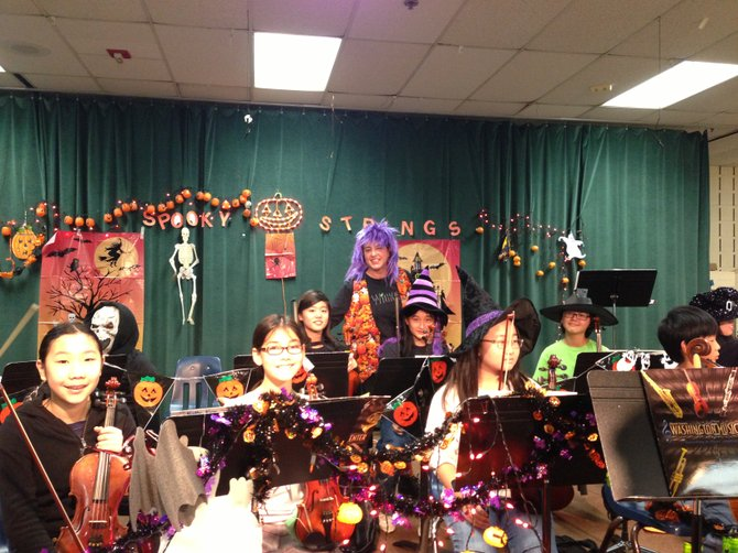 The Ghoulish Gang performs spooky strings tunes for White Oaks Elementary School in Burke on Wednesday, Oct. 31.