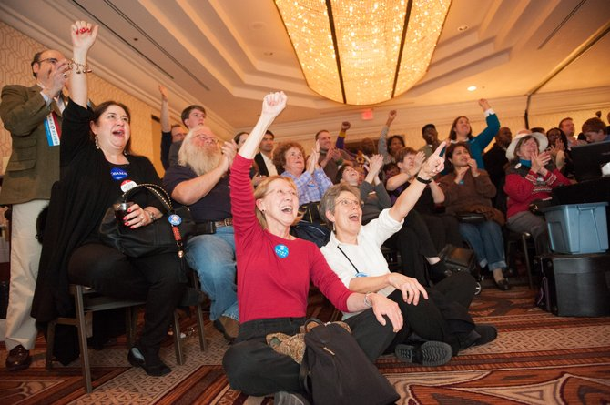 Reaction to the announcement that President Barak Obama has been reelected at the Fairfax County Democrats Victory Party on Nov. 6.