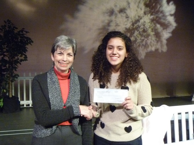 "ennifer Levy, the McLean Community Players chair, presenting the $200 award check to Sofia Padilla, winner of McLean Community Players' ""Last Summer"" essay-writing contest."