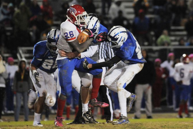 West Potomac defenders close in on T.C. Williams running back Dealo Robertson on Nov. 2.