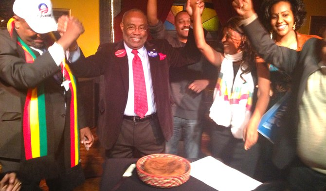 Alexandria Mayor Bill Euille celebrates victory with a traditional Ethiopian breaking-of-the-bread ceremony.