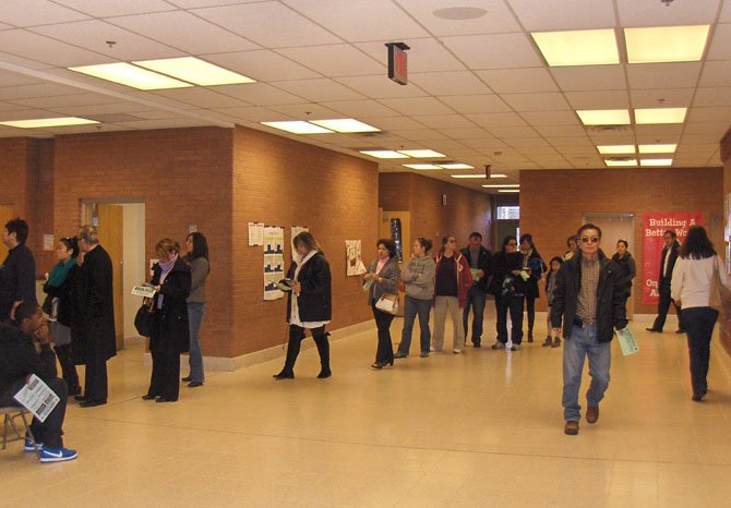 Residents in the voting line in the school hallway.