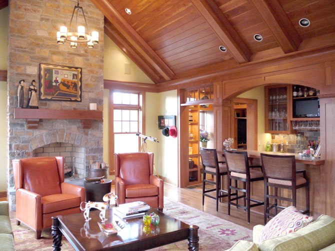 Architect Jim Rill and his team incorporated a bar and high ceilings in this Potomac family room. The ceiling and trim are stained cherry wood.