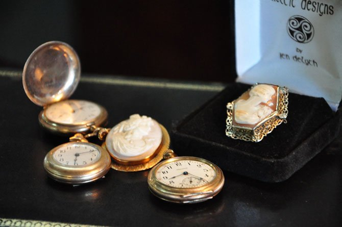 A selection of antique pins and pocket watches at Thieves Market in McLean.