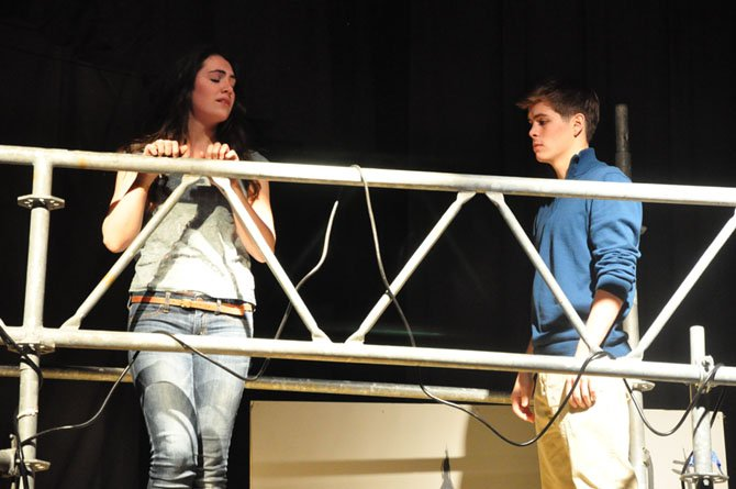 Juliet, played by Langley High School junior Kathleen Welch, tries to fend off the early affections of Romeo, played by senior Chris Paul, during the school's production of the play.