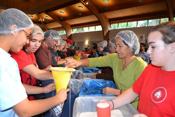 Volunteers measured and weighed each pre-packaged meal for consistency.
