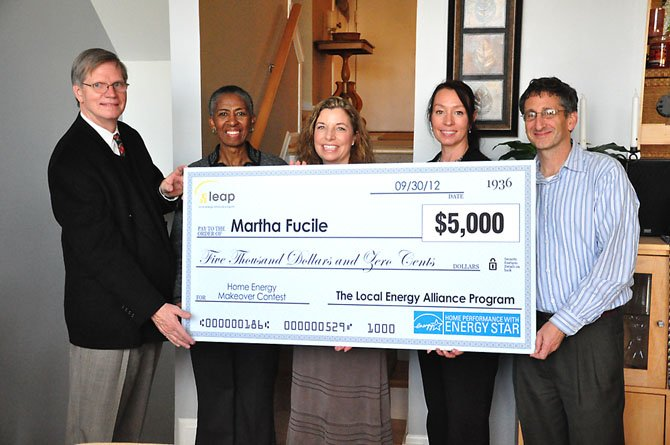 From left, Michael Sanio of the Reston Association Board of Directors, Supervisor Cathy Hudgins (D-Hunter Mill), homeowner Marti Fucile, Cynthia Adams of the Local Energy Alliance Program, and homeowner Eric Shor. Fucile and Shor were awarded $5,000 to make their Lake Audubon townhouse more energy efficient.