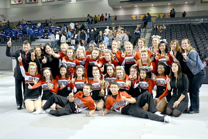 Herndon Varsity Co-Ed Cheer with the Virginia States Championship trophy. Back Row: Coach Deven Song, Coach Suzanne Mansfield, Coach Jenny Goff, Conlan Miller, Veronica Wood, Briana Heckard, Breana McPherson, Lexia Rowley, Lisa Sheffer, Bridget Nagy, Claire Barnes, Rebecca Valley, Margaret Schaaf, Macie Heuring, Shannon Kelley, Joanna Albert, Coach Anna Seymour, Coach Emma Collie. Middle Row: Zoe Langendorff, Marissa Foster, Bernadette Abadias, Alex Asack, Sarah Strangfeld, Kara Joyce, Hannah Moore, Meghan Henry, Inteha Hassan, Sheena Okai, Coach Hayden Little. Front Row: Alex Coffelt, Isaac Parada.