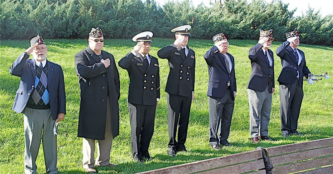 From left—David Lacombe, US Army Ret., William Spence, US Army Ret., Naval Academy sophomore Fabio Garcia, Naval Academy freshman John Wilson, William G. Wright, Sr., US Army Ret., Bob Thompson, US Navy Ret., and Eric Clauch, US Airforce. The veterans insisted that the young naval cadets join them in the military line-up. Garcia and Wilson were both members of the Herndon Junior Naval ROTC before taking the next step in their careers at the Naval Academy.