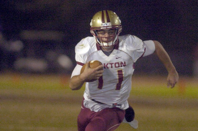 Oakton quarterback Kyle Downer rushed for 152 yards and three touchdowns during a playoff victory against Lake Braddock on Nov. 9.