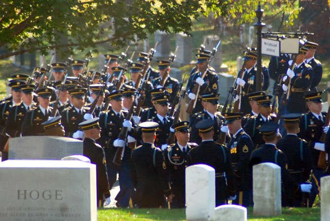 The 3d U.S. Infantry Regiment (The Old Guard) march through Arlington cemetery before the arrival of President Barack Obama on Veterans Day.