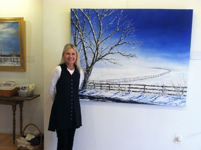 "Artist Claire Howard with her painting ""A Heavenly Peace."""