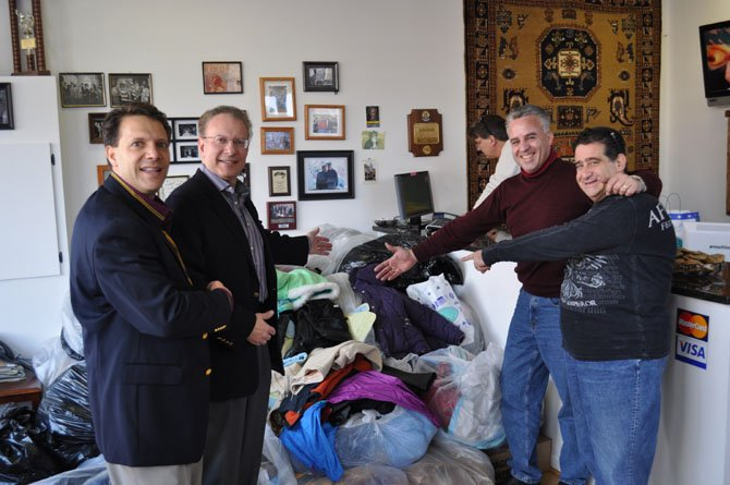 Joe Hadeed, left, and Hadeed Carpet collected more than 1,700 coats during last year's coat drive. This year's event will be held No. 17 from 8 a.m. to 5 p.m. at 3206 Duke St.
