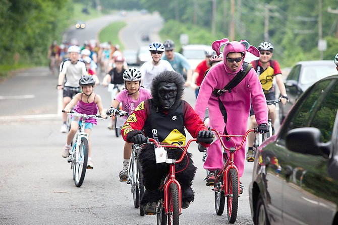 "Andrew Steele of Reston—aka ""the gorilla""—and Joe Penano of Fairfax Station—aka ""the bunny""—helped lead the parade of cyclists down Old Keene Mill Road in Springfield during The Bike Lane's Relocation Ride last year."