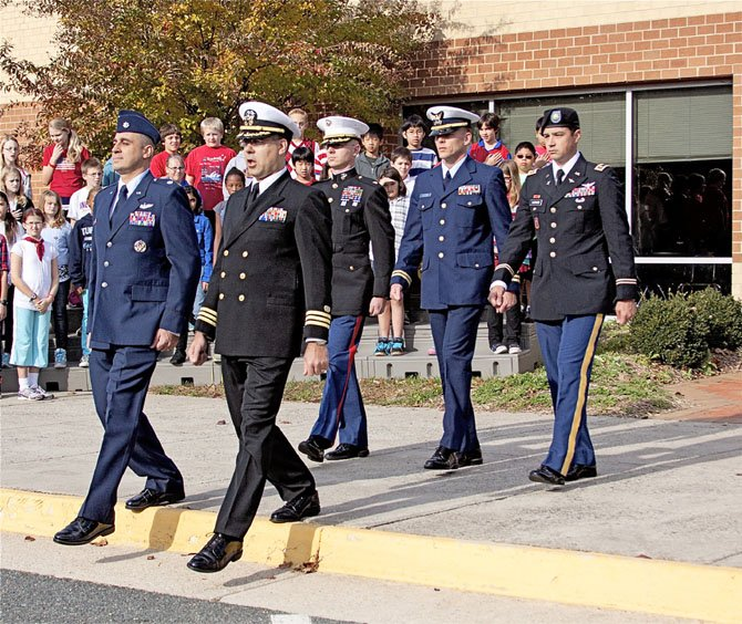A very special color guard raised the flag at the Sangster Elementary School Veterans Day observance. Officers from all military branches did the honors. Front row, from left, Lt. Col. Jason Pavelschak, US Air Force, Commander Dom Flatt, US Navy. Back row, Major Brian Mahler, US Marine Corps, Lt. Michael Whitredge, Coast Guard, and Major Luke Karnes, US Army.