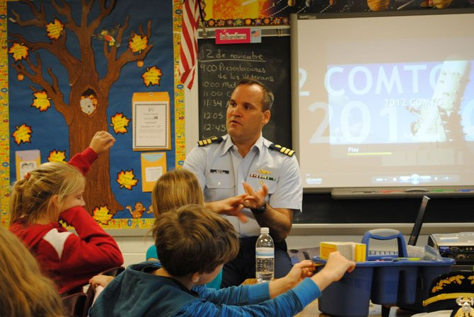 LTC Conmey visits with Ms. Giblin's first grade class.