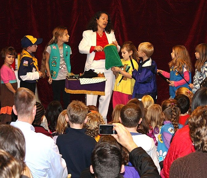 Laurie Curry had a group of children enthralled during her performance at last year's holiday magic show, featuring the International Brotherhood of Magicians Ring 50 club.