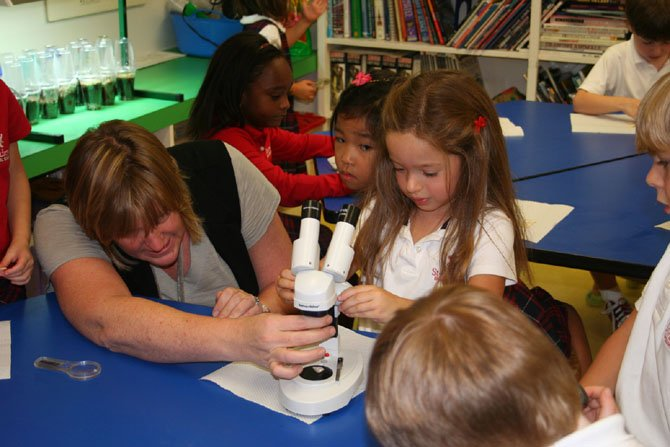 "Instructor Laura Hoffman teaches a science class at St. Andrew's Episcopal School in Potomac, Md. Independent school officials say interviews with applicants and their families help identify students who fit ""the personality of the school."""