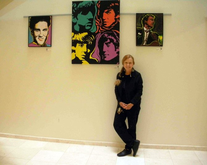 Artist Rosemary Gallick has paintings on exhibition in three locations this month. She is shown here with her paintings at the Reston Association. Gallick teaches art history at Northern Virginia Community College.