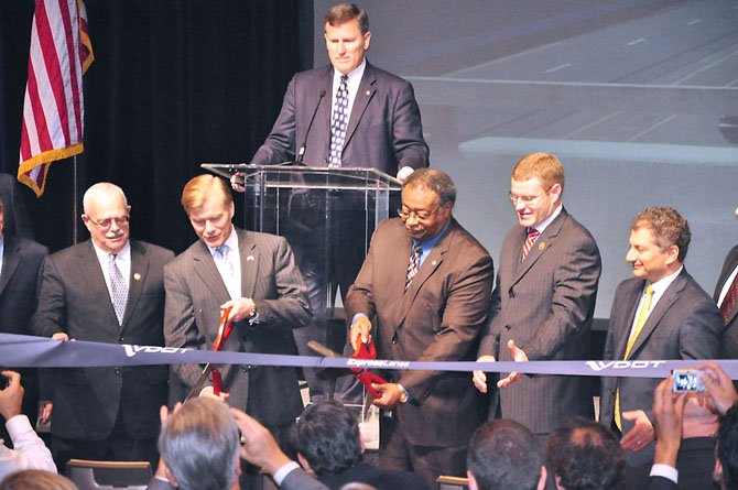 Gov. Robert McDonnell cuts the ribbon on the 495 Express Lanes Tuesday, Nov. 13 at the Sheraton Tysons. 