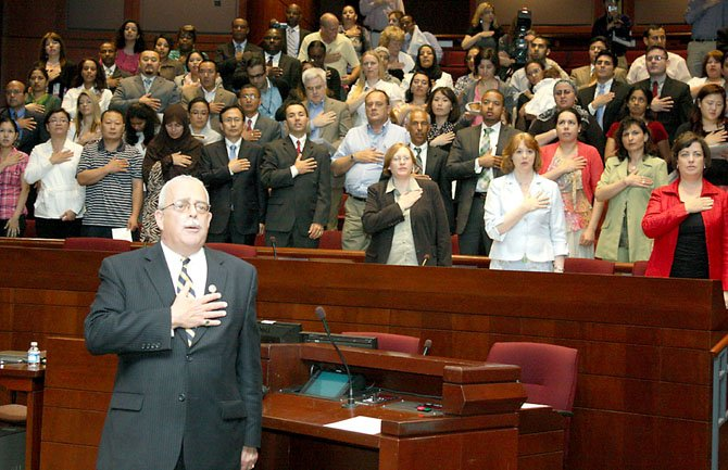 Connolly leads Pledge of Allegiance for new citizens.