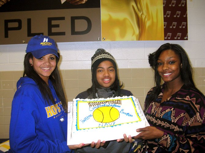 From left: Mount Vernon seniors Kelly Loftus, Taylor Dunham and Tiffany Webster are seen during a college signing party at MVHS on Nov. 14. Loftus signed with Hofstra. Dunham plans to sign with Navy in the spring and Webster plans to sign with Barton College in the spring.