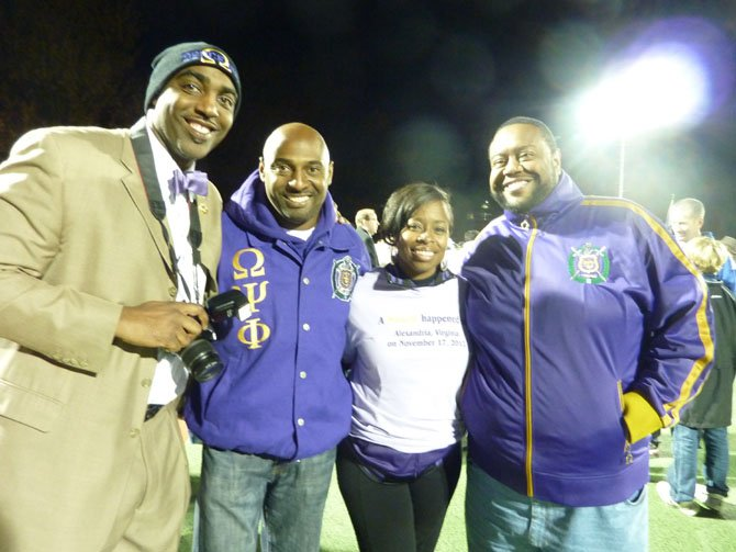 Therapeutic recreation staff member Brenda Holloway, second from right, poses with Omega Psi Phi fraternity members Kyle Hill, Melvin Stalligs and Tellas Minor. The fraternity provided free concessions to participants and their families during the Miracle League season.