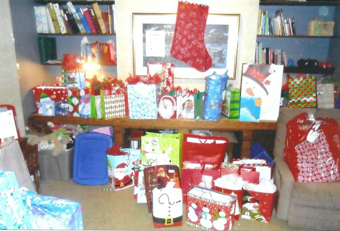 Gifts are brought to Ginger Mahon's house on the day of the donation drive in December of 2011.