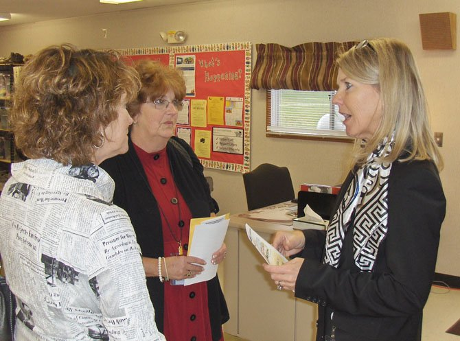 From left: Mary Shepherd, who oversees the parent centers for FCPS; Bette Morris, Cluster VII representative for Family and School Partnerships and Bull Run Principal Patti Brown chat inside the new family center.