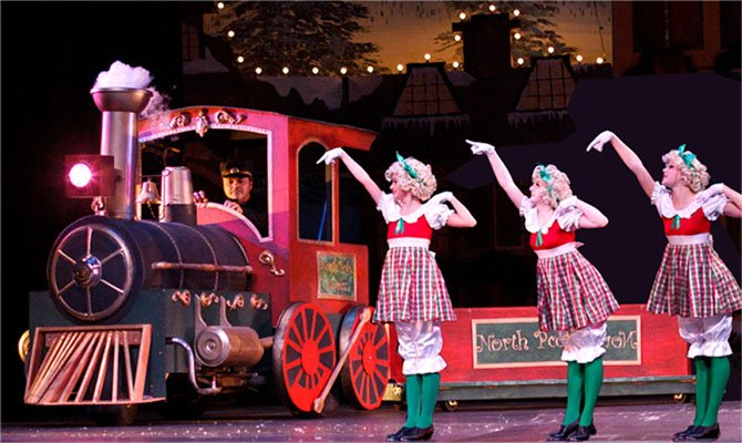 Dolls and a train are at the North Pole in Encores annual holiday show.
