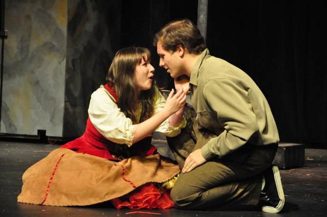 "Fiona (played by Molly Nuss) and Tommy (played by Paul Morgan) struggle with their feelings for each other during a scene in Herndon High School's production of ""Brigadoon."""