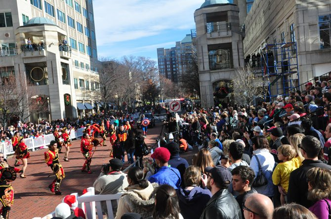 The crowd at the annual Reston Holiday Parade watches a Bolivian dance troupe Friday, Nov. 23 at Reston Town Center.