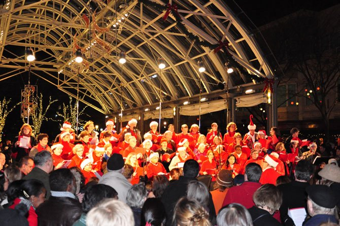 Members of the Reston Chorale perform at the annual tree lighting ceremony at Reston Town Center Friday, Nov. 23. 