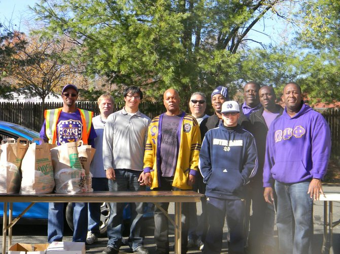 Men from Fairfax and Loudoun volunteered together and managed the constant traffic of shopping carts as 50,000 pounds of non-perishable groceries were loaded into vehicles of families in need from Sterling, Ashburn and Herndon. Christ the Redeemer Catholic processed 55 families an hour, totaling 397 carts between 8 a.m. and 3 p.m. Working in parallel, Trinity Presbyterian in Herndon handled 404 grocery carts. Seventy-three walk-in families were served at the end of the day. 