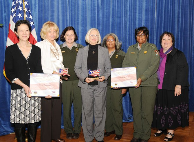 At the Department of Interior's National Volunteer Award presentation, from left, are Rhea Suh, Assistant Secretary of Interior; Judy Sherman, award winner; Donna Cuttone, National Park Service ranger; Sandy Newton, award winner; Delphine Gross, National Park Service ranger; Jacqueline Davis, National Park Service ranger, and Lisa Young, Department of the Interior program specialist.