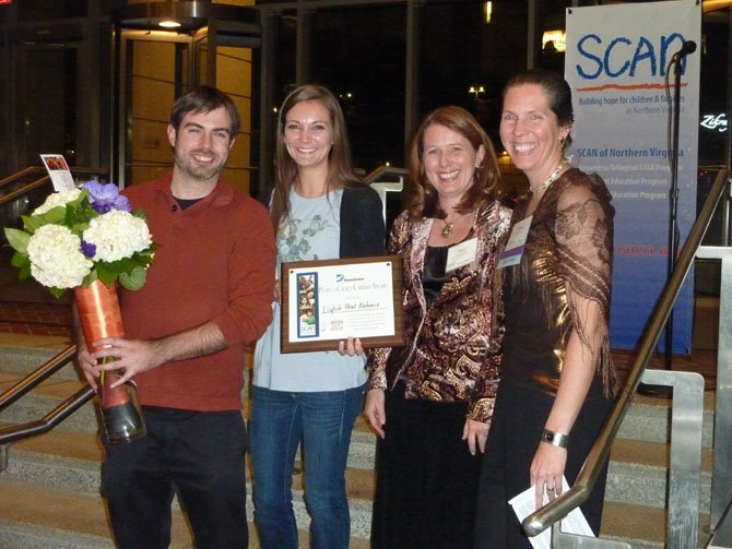 Dave Davies and Elizabeth Harmon of Dogfish Head Ale House receive the evening's culinary award from Dominion Power's Kimberly Campbell and SCAN executive director Sonia Quinonez.