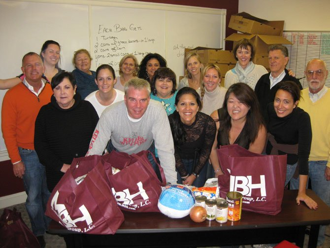 Keller Williams staff and friends after sorting and bagging 126 Thanksgiving dinners in the Old Town office last week.